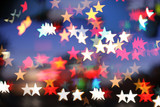 Blurred holiday background with star-shaped highlights. poster