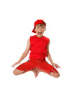 Thrilled boy jumps off ground with feet in tight to his body. poster