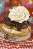 a chocolate eclair with whipped cream