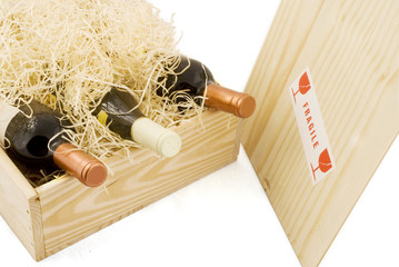 wooden box with three bottles of wine