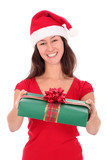 Smiling Woman Wearing a Santa Hat Carrying Christmas Present poster