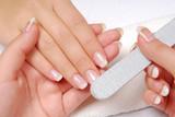Studio nail — beautician polishing female nails poster