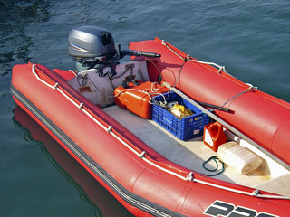 Red rigid-inflatable boat