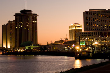 Hotels and casinos on Mississippi river at sunset