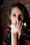 young beauty girl with white bandage on the hand poster
