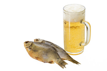 Mug with beer and dried fishes