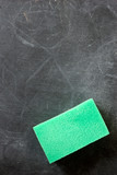 close-up of blackboard with cleaning sponge on it poster