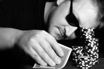 Poker gambler close-up. Black and white image.