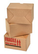 close-up of three cardboard boxes againt white background,