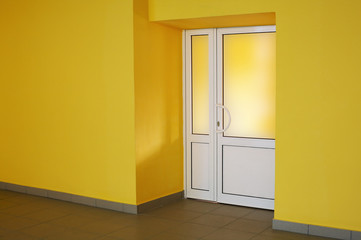 The glazed door in a yellow room