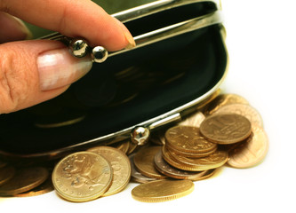 Female fingers open a purse with Russian coins