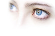Close up view of a young woman's beautiful blue eyes