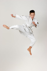 boy jump in the kimono, practice of aikido