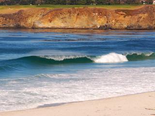 Surf crashing on Carmel Beach below Pebble Beach golf course