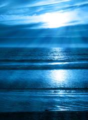 Beams of Light on a Blue Ocean Sunset