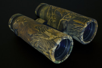 camouflage binoculars on black