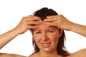 Woman with splitting headache rubbing forehead for relief