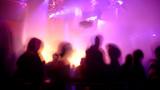 Nightclub scene with dance floor crowd in motion poster