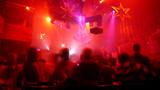 Nightclub scene with christmas decor and dance floor crowd poster