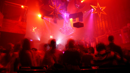 Nightclub scene with christmas decor and dance floor crowd