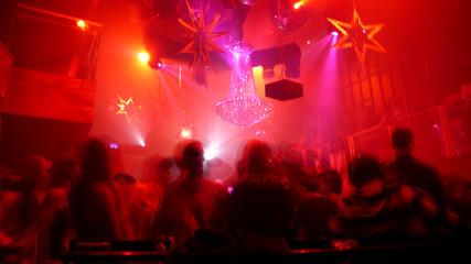 Nightclub scene with christmas decor and dance floor crowd