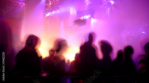 Nightclub scene with dance floor crowd in motion - 5462228