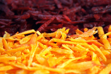 Cutting beetroot and carrot as background