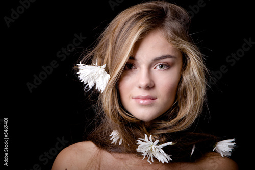 Woman with long hair with flowers