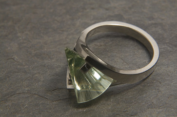 peridot with a lighthouse cut on white gold