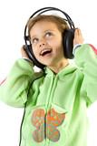 Fototapety Little fun girl listening music in headphones. Isolate on white.