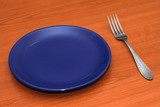 Blue empty plate with a fork poster