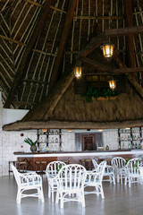 tropical bar in hotel with white wicker chairs