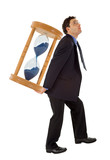 Businessman carrying a hourglass - isolated poster