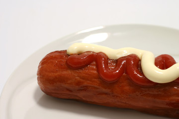 Sasusge with ketchup and mayonnaise