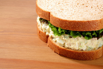 Tuna salad sandwich on wheat bread with lettuce