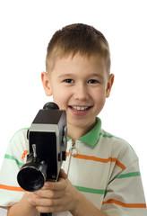 The smiling boy with retro a movie camera