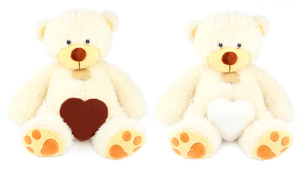 two white teddy bears and two honey-cakes