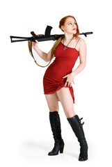 Alerted girl in red dress with a gun