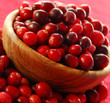 Fresh red cranberries in a wooden bowl