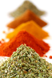 Heaps of various ground spices on white background poster