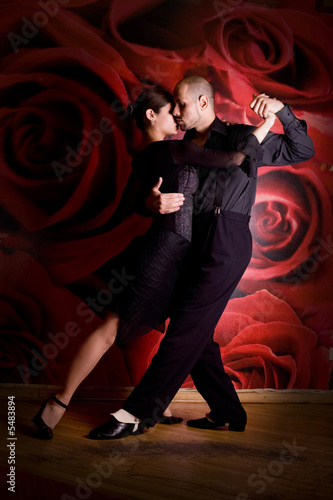 young couple in love at the nightclub dancing Latino dance
