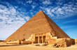 Ancient egyptian pyramid against blue sky