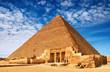 Ancient egyptian pyramid against blue sky
