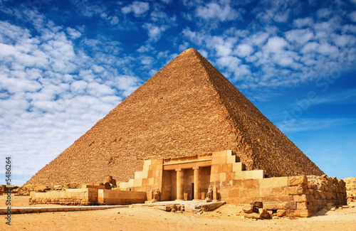 Plexiglas Egypte Ancient egyptian pyramid against blue sky