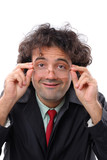 Man making a shy smile and holding his glasses . poster