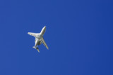 Private Jet flying overhead after takeoff  poster