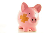 Piggy bank with bandage, metaphor for healthcare costs poster