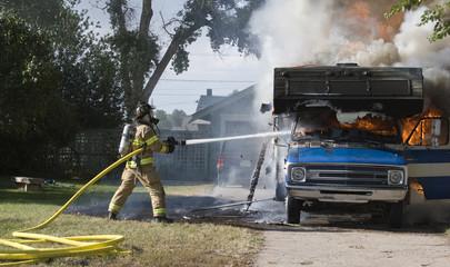 Firefighter battles RV fire