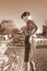 diffused image of a young gentleman helping a little girl
