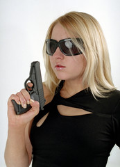 strong woman with black gun